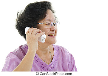 Senior adult woman calling on phone