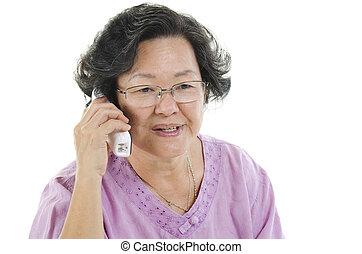 Senior adult woman calling on telephone
