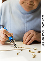 senior adult woman is creative - senior adult woman is doing...