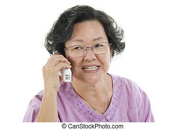 Senior adult woman on the phone