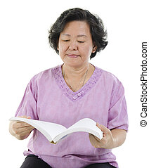 Senior adult woman reading book