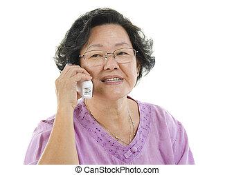 Senior adult woman talking on telephone