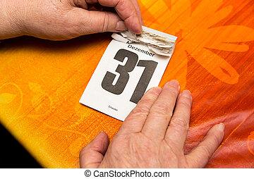 senior adults hands with calendar