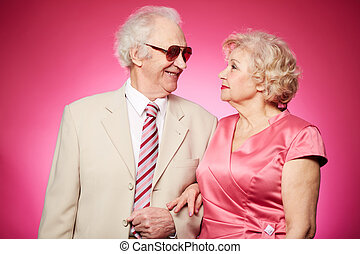 Senior affection - Affectionate seniors standing arm-in-arm...