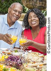 Senior African American Couple Drinking Orange Juice