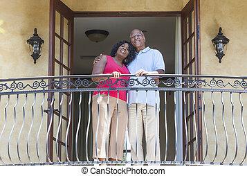 Senior African American Man & Woman Couple on Balcony