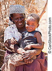 senior African woman - portrait of an happy old African...