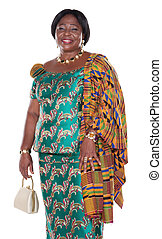 senior African woman with traditional Ghana clothing, green dress and white handbag