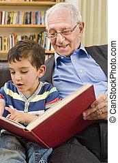 senior and child reading