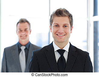 Senior and Junior business looking at the camera - Two...