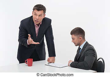 Senior and junior business people discuss something during their