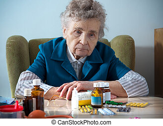 senior and medicine - senior woman with her medicine bottles