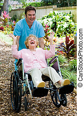 Senior and Orderly Clowning Around - Friendly orderly and...