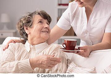 Senior and private carer - Photo of smiling positive senior...