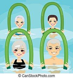 Senior Aqua Gym Foam Rollers - Small group of senior people...