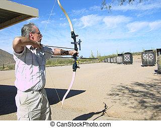 Senior Archer - Senior competitive archer at archery range