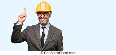 Senior architect or engineer raising finger, the number one