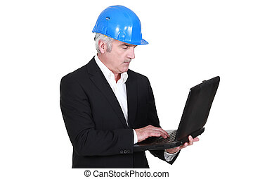 Senior architect with computer in hand