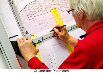 Senior architect working on drawing board