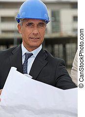 Senior architect working on-site