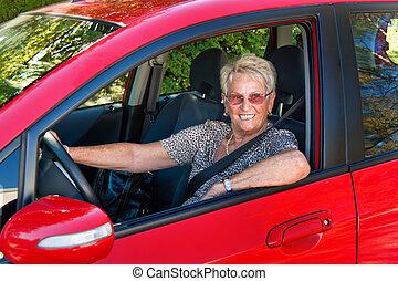 Senior as a car driver in the car. Belt buckle