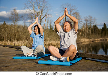 Senior asian couple exercise - A senior asian couple...