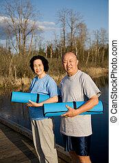 Senior asian couple exercise