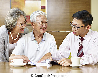 senior asian couple meeting a sales rep
