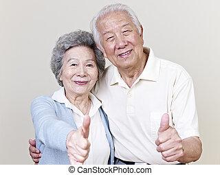 senior asian couple - portrait of a senior asian couple,...