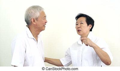 Senior Asian couple talking