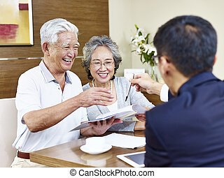 senior asian couples ready to sign contract