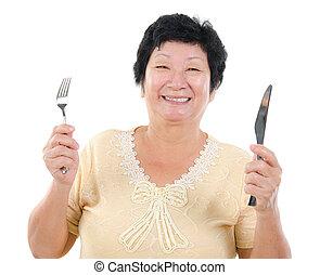 Senior Asian having meal