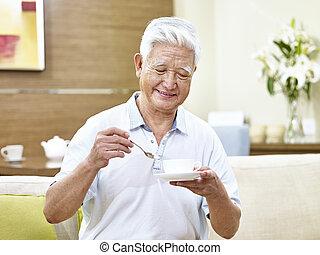 senior asian man drinking coffee