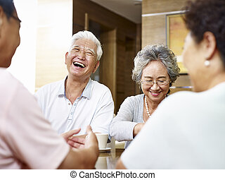 senior asian people having a good time - senior asian people...