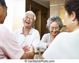 senior asian people having a good time