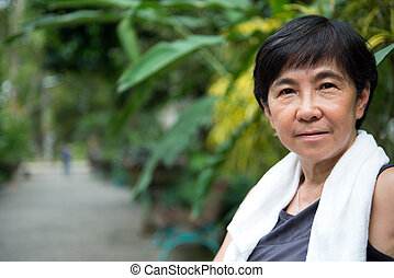 Senior Asian woman in park