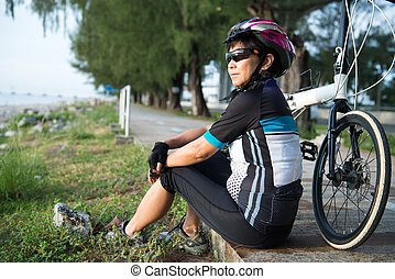 Senior Asian woman riding a bicycle