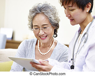 senior asian woman seeing family doctor