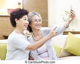 senior asian women taking a selfie