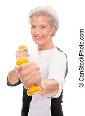Senior at workout - Active senior woman at workout in front ...