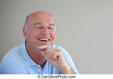 Senior bald man laughing