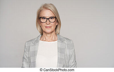 Senior blonde woman is wearing glasses isolated
