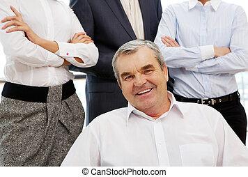 Senior boss - Portrait of confident boss looking at camera...
