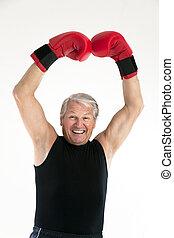 senior boxer - happy senior man with red boxing gloves