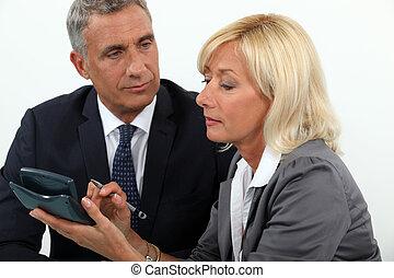 Senior business couple going over finances