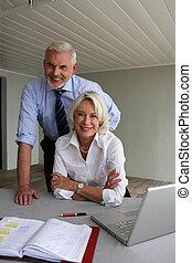 Senior business couple