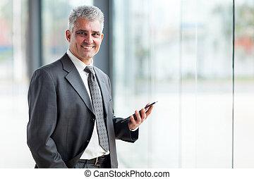 senior business executive using tablet pc