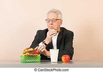 Senior business man eating healthy lunch - Senior business...