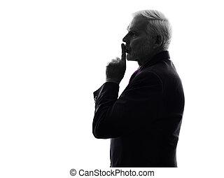 senior business man hushing finger on lips silhouette