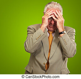 Senior Business Man In Tension Isolated On Green Background
